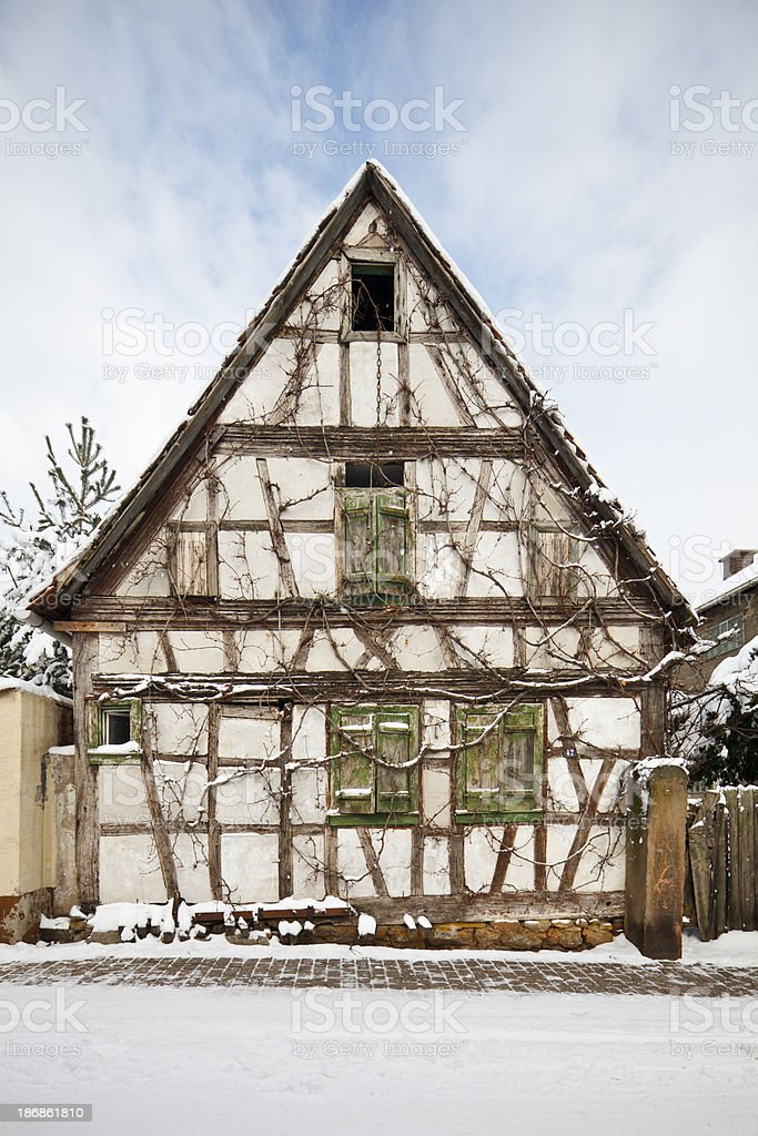 Overgrown Half-Timbered House In Village royalty-free stock photo