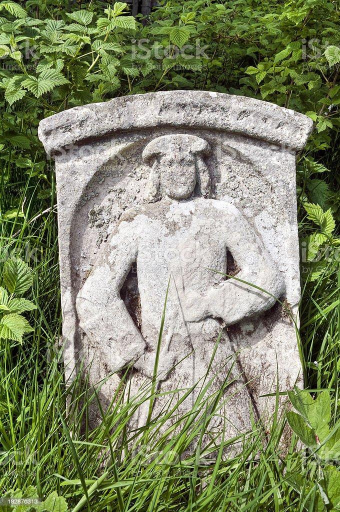 Overgrown old symbolic gravestone, Scottish Borders, UK royalty-free stock photo