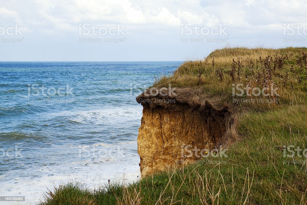 Overhanging cliff edge and North Sea royalty-free stock photo