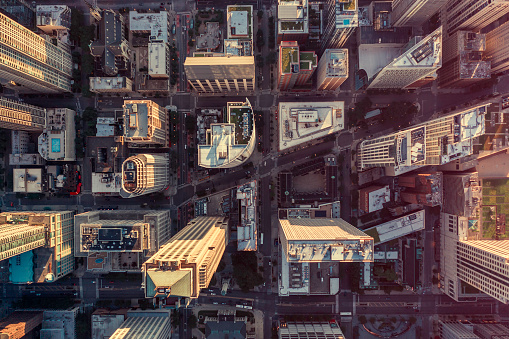 Overhead aerial view of Chicago Downtown skyscrapers. Urban grid with streets. Late afternoon light