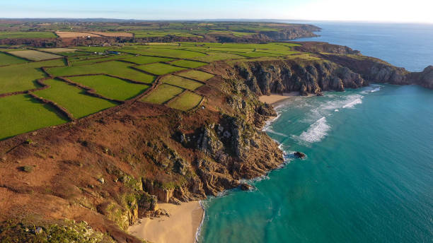 Overhead, aerial view of the Sandy beach and cove of Porthcurno on the southwest coast of Cornwall, England stock photo