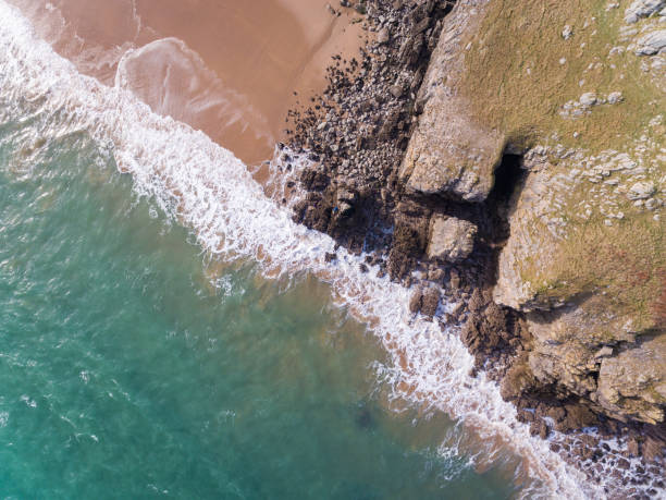 Overhead Aerial view of Waves on a beach stock photo