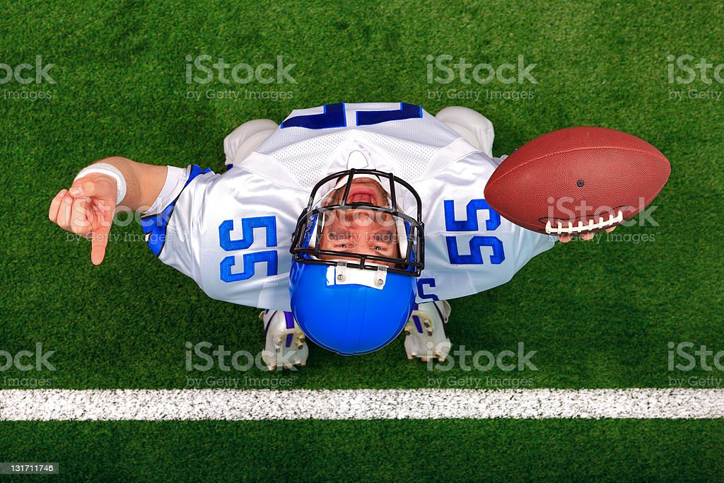 Overhead American football player touchdown celebration royalty-free stock photo