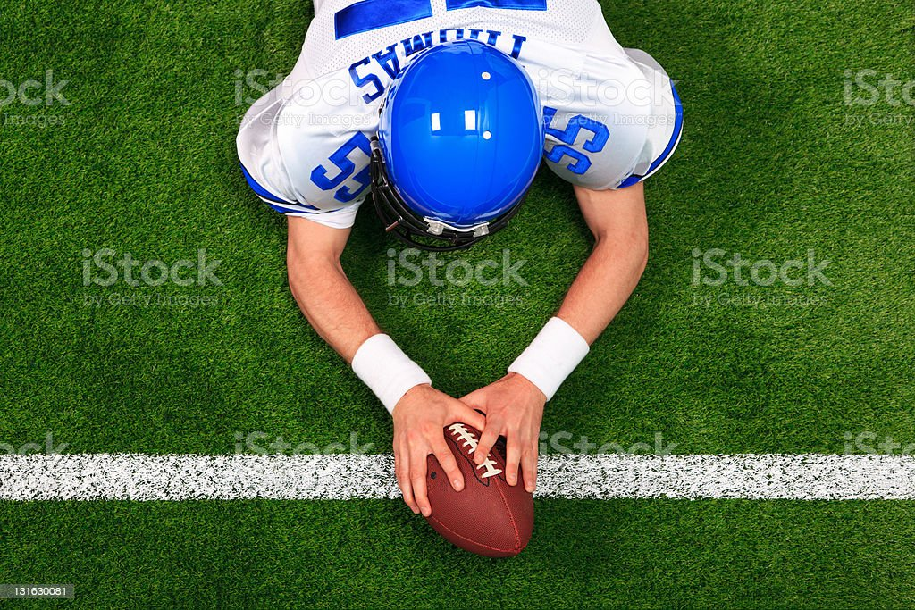 Overhead American football player touchdown stock photo