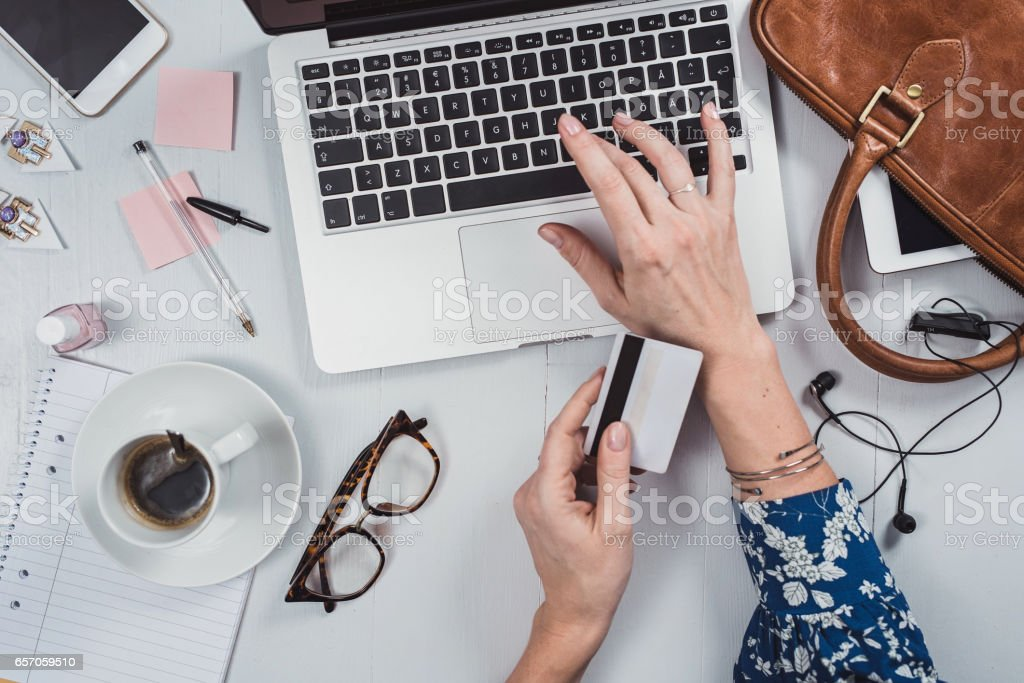 Overhead Business Angles woman at office desk stock photo
