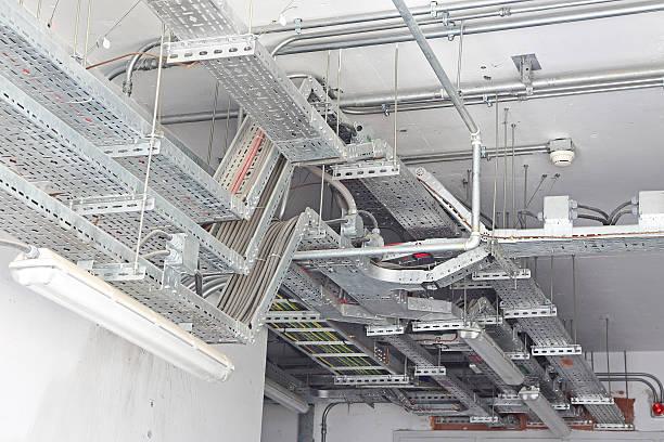 overhead cable management - elektrische fitting stockfoto's en -beelden
