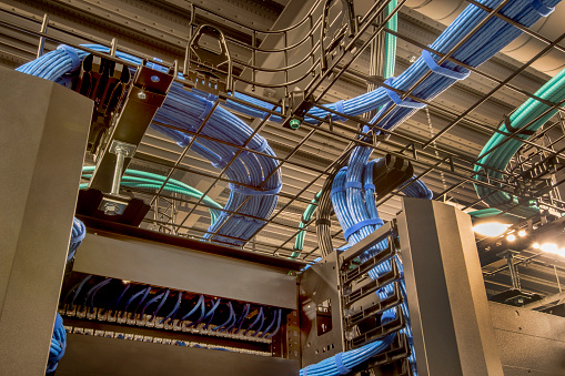 Cable trays in a data center with cat 5 and optic fiber cables.
