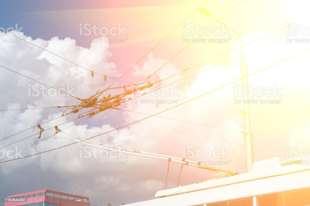 Overhead catenary, part of overhead line equipment of passenger city...