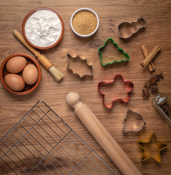 overhead christmas baking with equipment and ingredients - christmas stock photos and pictures