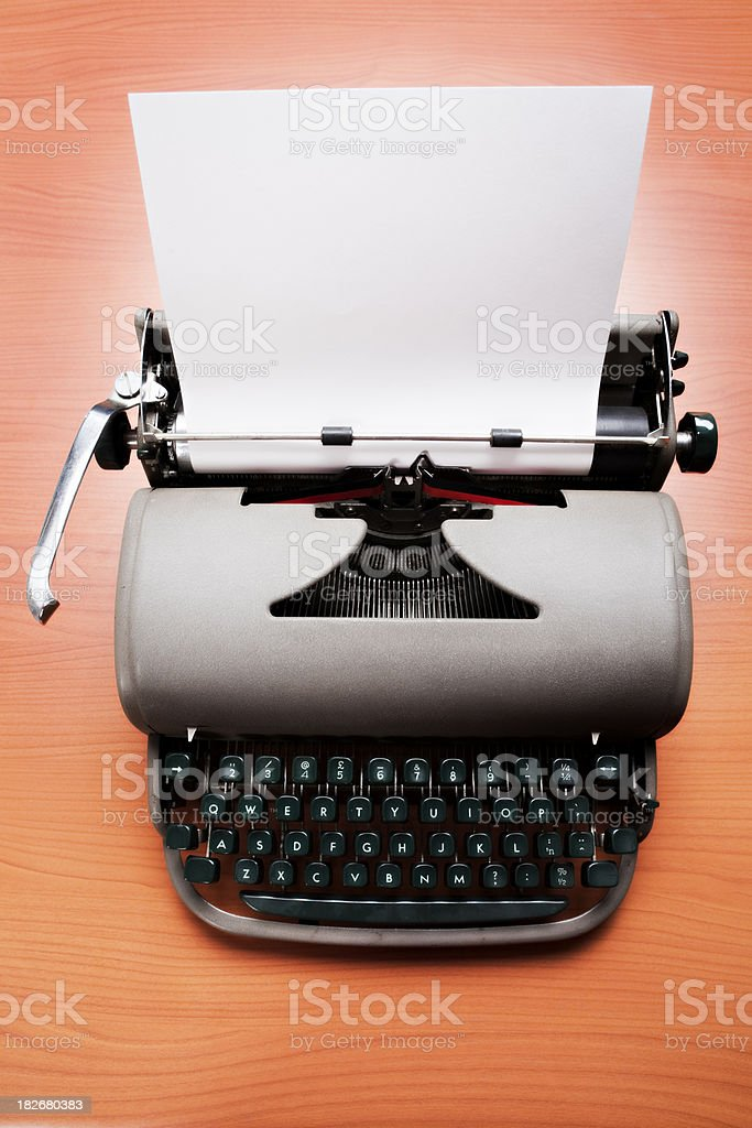 Overhead close up shot of vintage typewriter with blank paper royalty-free stock photo