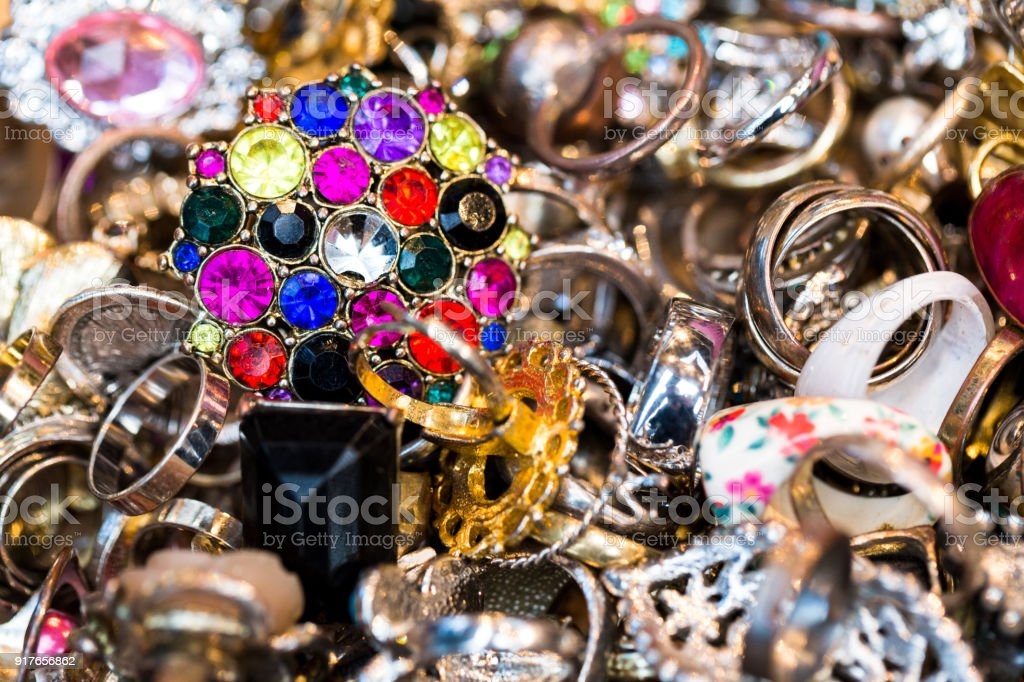 Overhead close up view of collection of rings and jewelry for sale stock photo