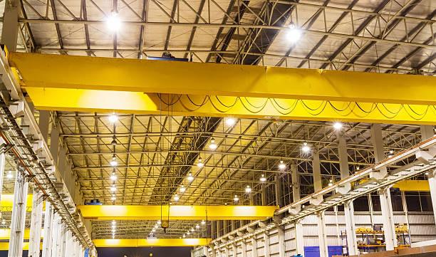 Overhead crane in production line stock photo