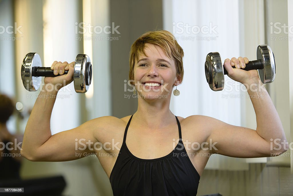 Overhead Dumbell Press - Fitness royalty-free stock photo