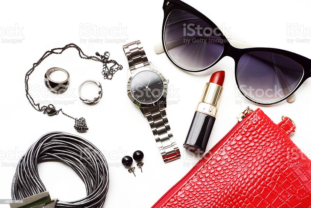 Overhead fashion female accessories watch sunglasses red purse. stock photo
