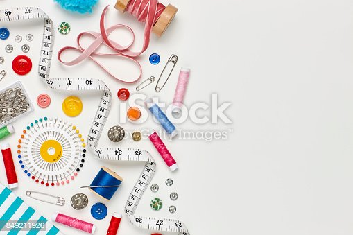 istock Overhead flat lay of colorful sewing equipment on white background 849211926