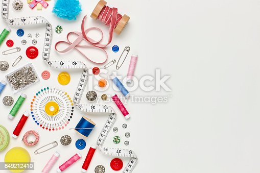 istock Overhead flat lay of colorful sewing items on white background 849212410