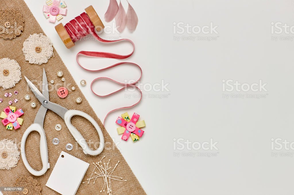 Overhead flat lay of craft materials on white background stock photo