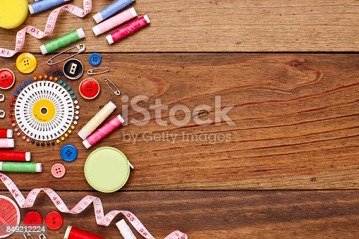 istock Overhead flat lay of sewing items on wooden table 849212224