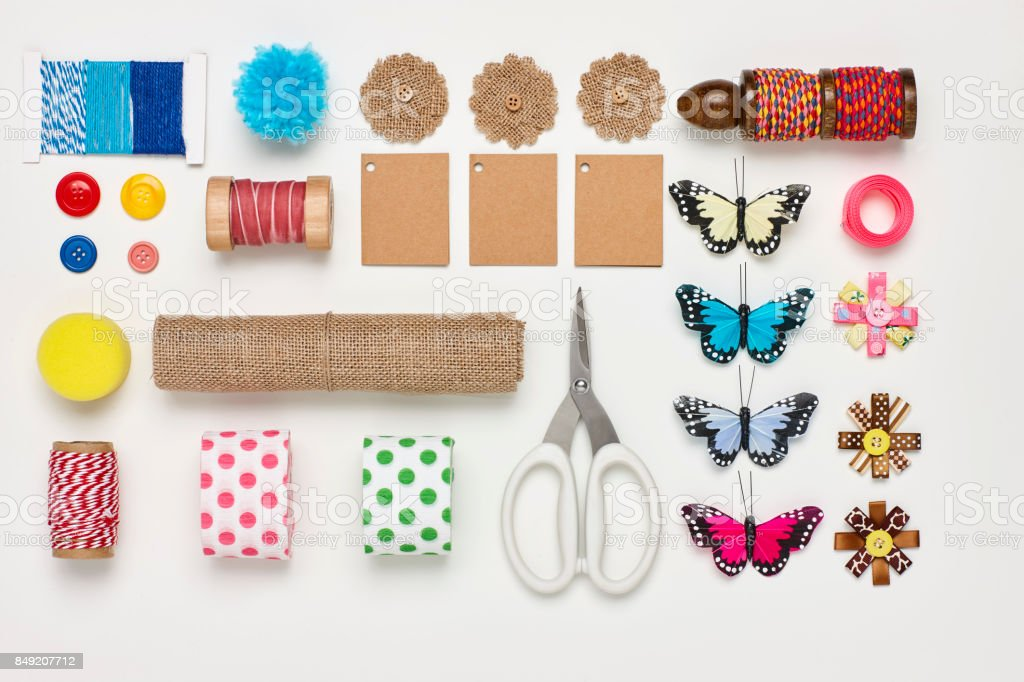Overhead flat lay of various craft products on white background stock photo