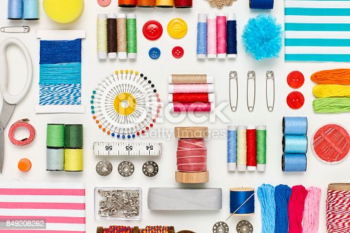 istock Overhead flat lay of various sewing items on white background 849208262