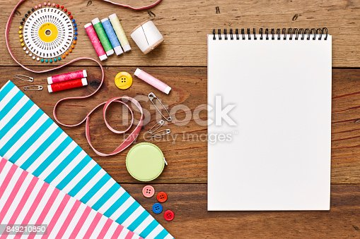 istock Overhead flat lay sewing equipment spiral book of wood 849210850