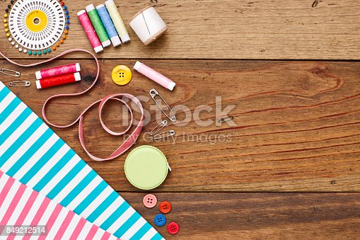 istock Overhead flat lay sewing products and striped fabrics of wood 849212514