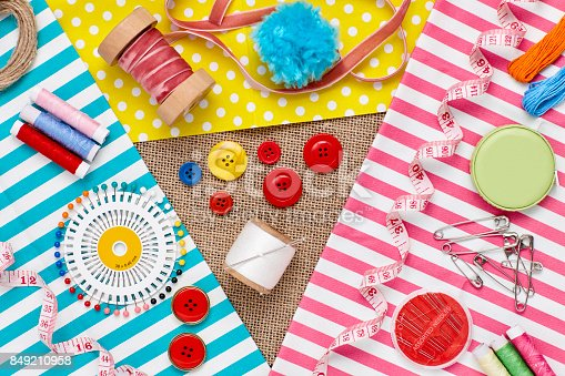 istock Overhead full frame shot of sewing items and textiles 849210958