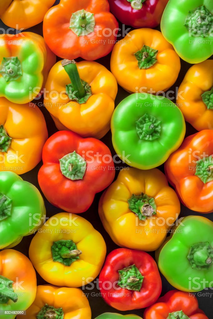 Overhead group of  colorful red green, orange yellow bell pepper stock photo