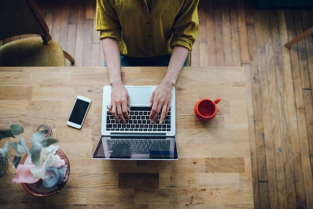 overhead image of a female blogger writing on the laptop - montmatre utsikt bildbanksfoton och bilder