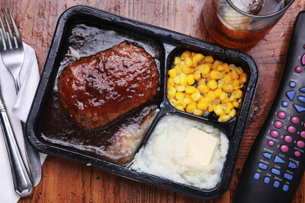 Overhead image of a TV dinner on a wood table stock photo