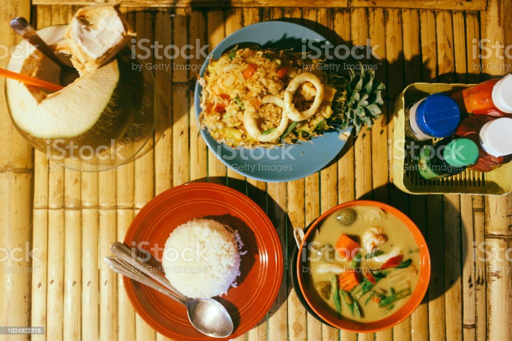 Overhead Image Of Authentic Thai Food Served In A Beach
