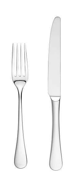 overhead knife and fork isolated on white with paths stock photo