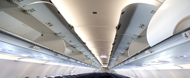 Overhead Luggage Storage On Empty Airplane Stock Photo