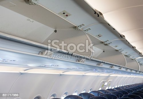 istock Overhead luggage storage on empty airplane 831717986