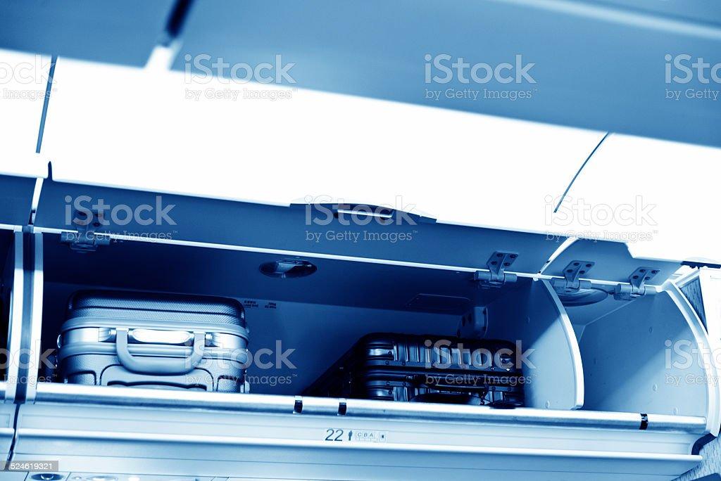 overhead luggage storage stock photo