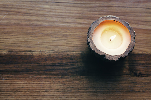 istock Overhead of a burning decorative candle 492630922