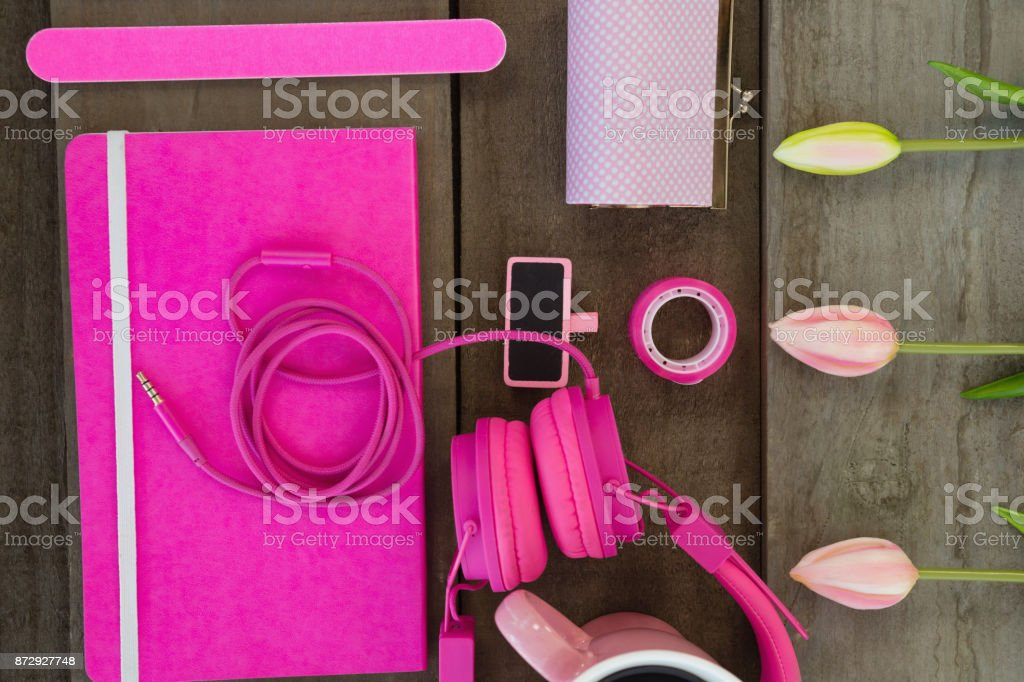 Overhead of female accessories and stationery stock photo