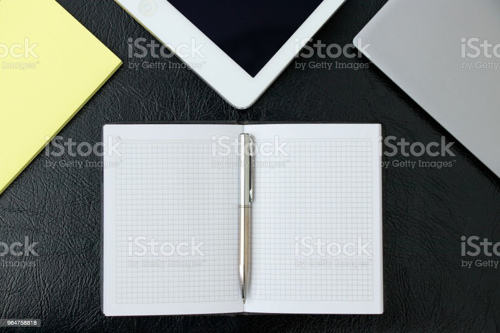 Overhead of office table with laptop, tablet pc and sticky notepad, pencil. copy space royalty-free stock photo