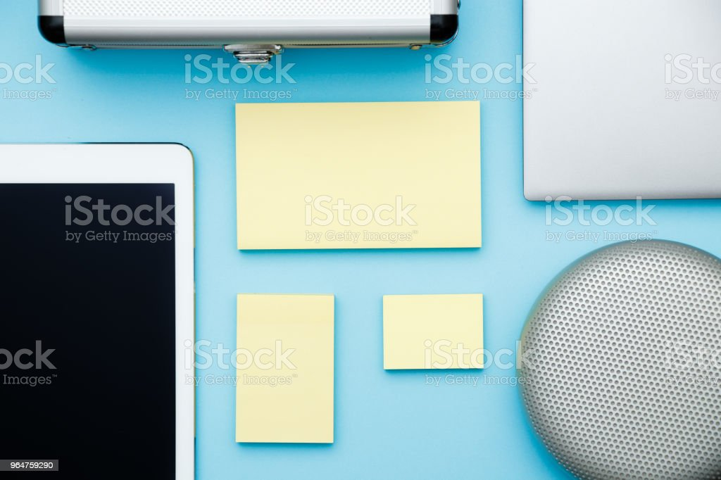 Overhead of office table with laptop, tablet pc and sticky notes, pencil. copy space flat lay royalty-free stock photo
