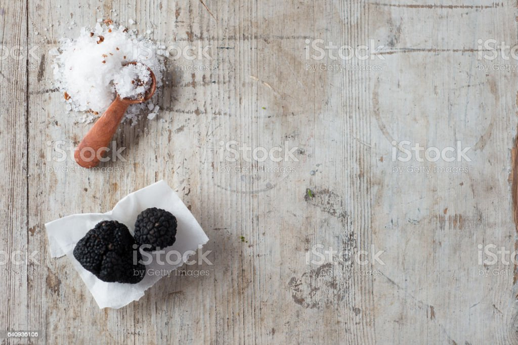 Overhead of Salt and Black Truffles with Copy Space stock photo