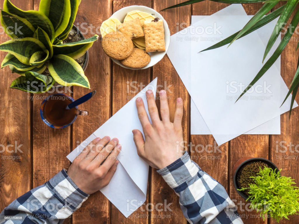 overhead person making diy things with paper royalty-free stock photo