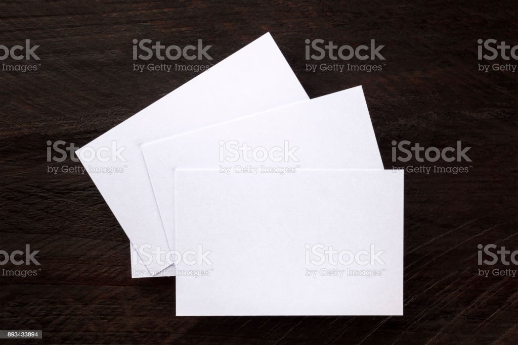 Overhead photo mockup of blank white business cards stock photo