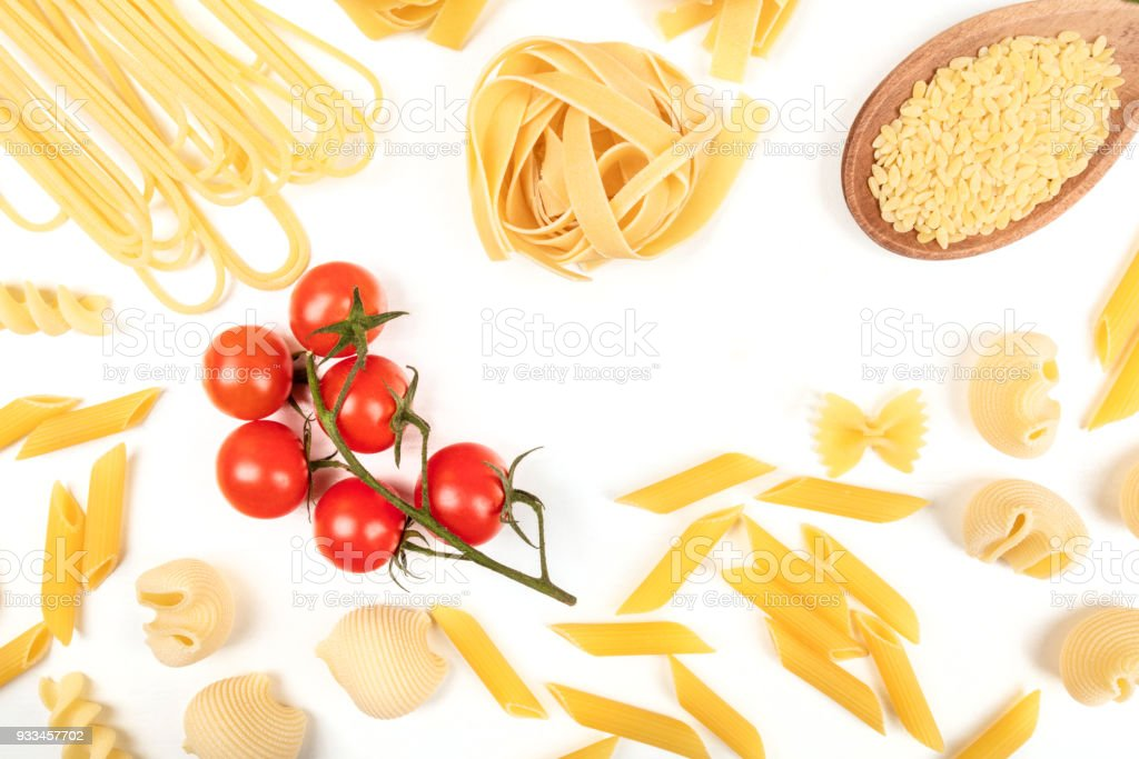 Overhead photo of different types of pasta on white with copy space stock photo