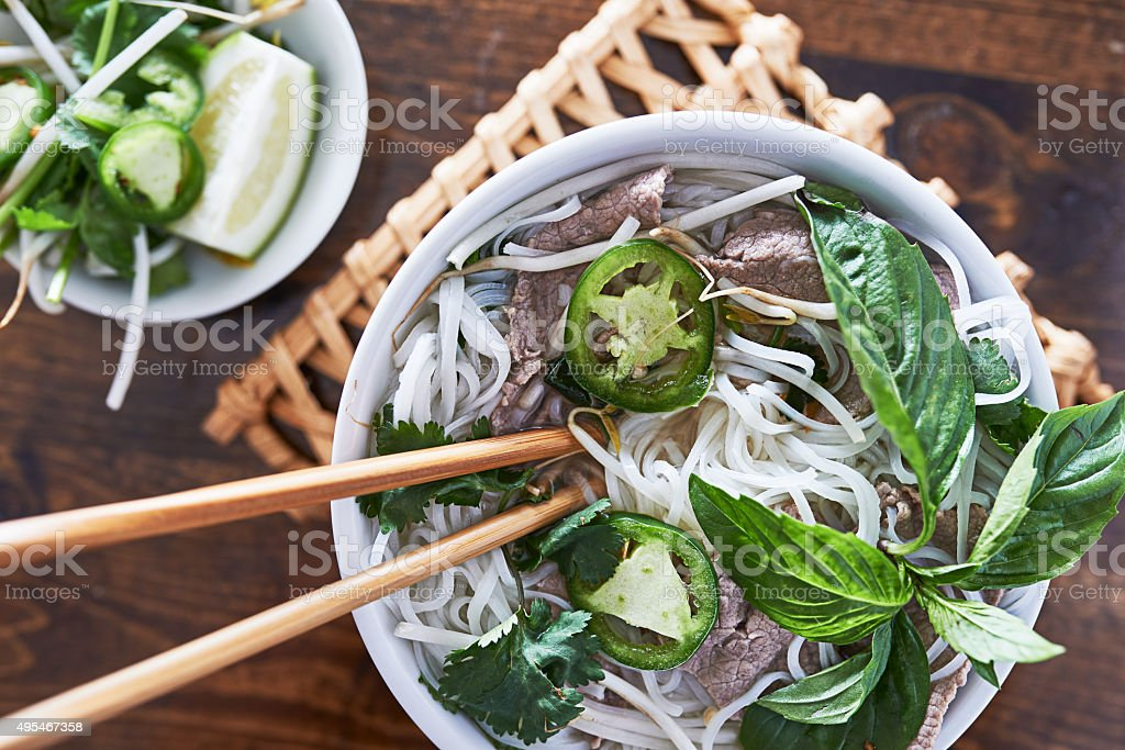 overhead photo of eating vietnamese beef pho stock photo
