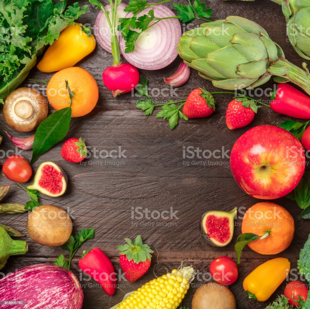 Overhead photo of fresh vegetables and fruits with copy space stock photo