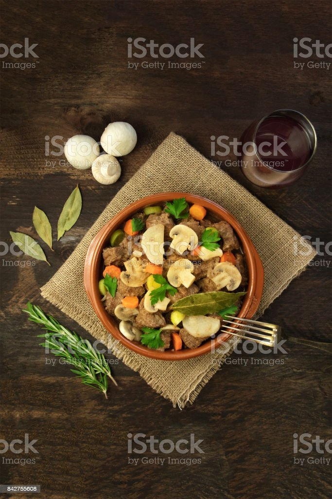 Overhead photo of meat and mushrooms ragout with wine stock photo