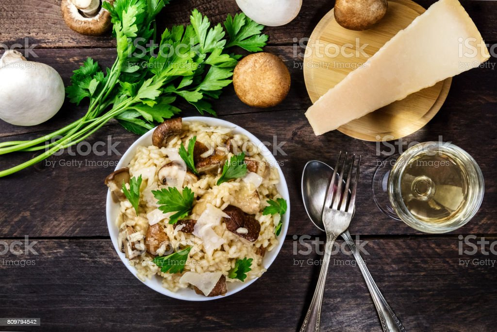 Overhead photo of mushroom risotto with ingredients and copyspac stock photo
