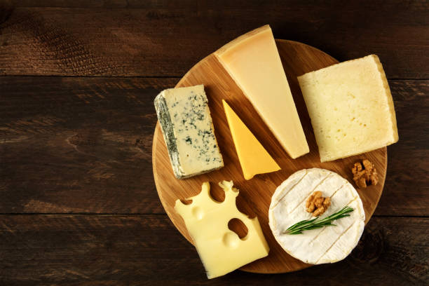Overhead photo of selection of cheeses with copyspace stock photo