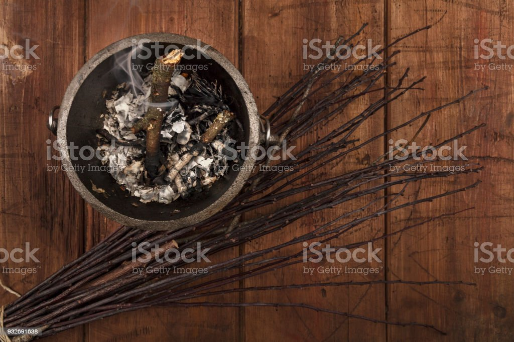 Overhead photo of smoking witch's cauldron with broom and copy space stock photo