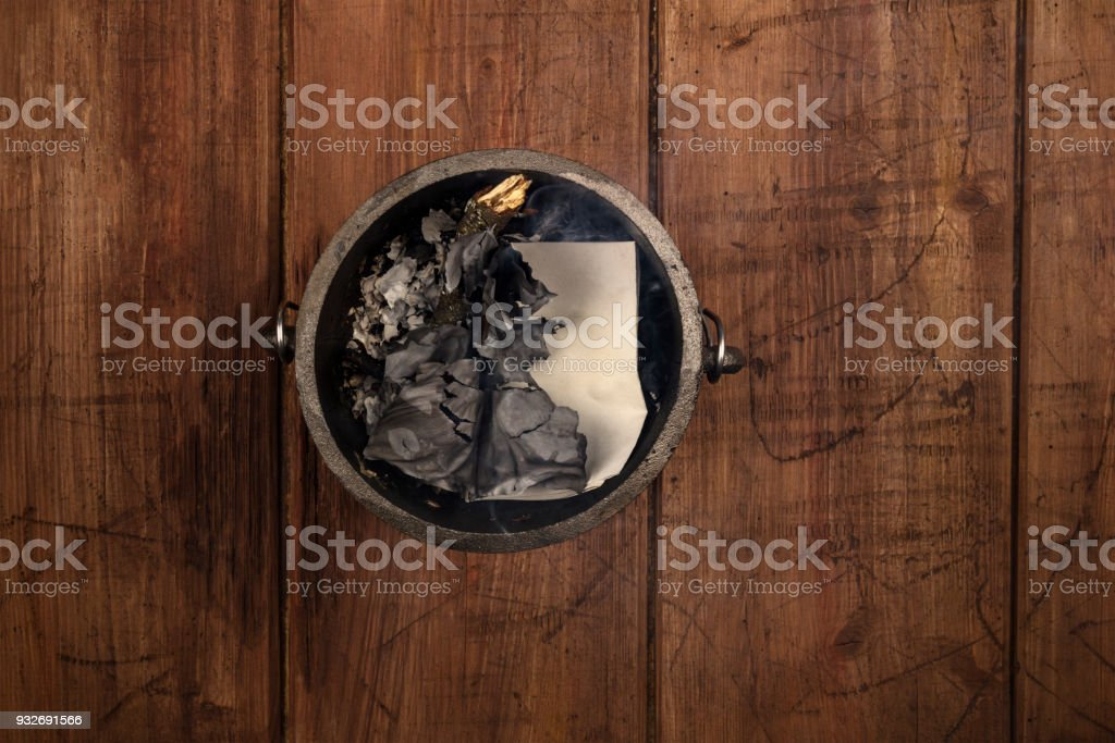 Overhead photo of witch's cauldron with smoke stock photo